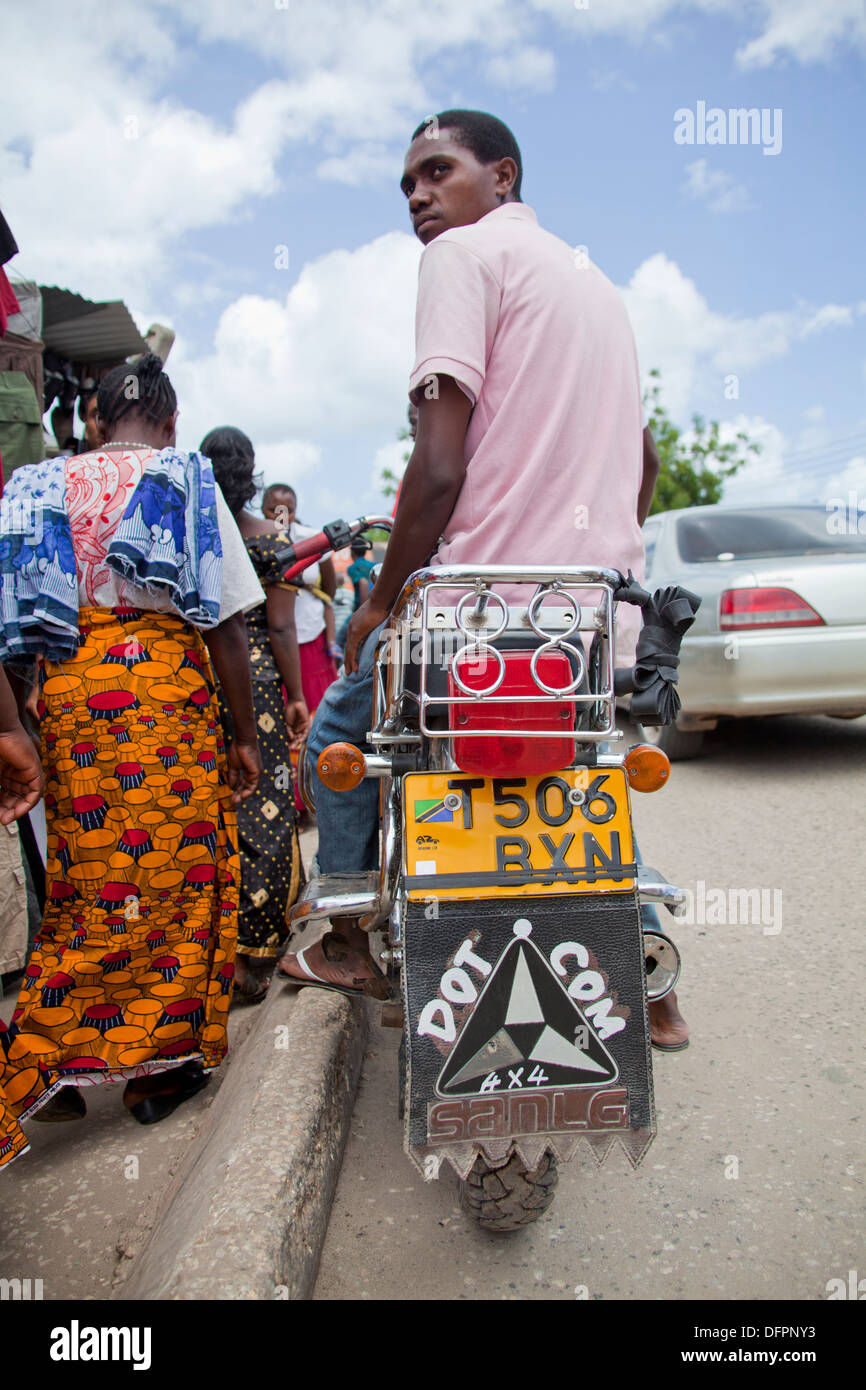 Tanzanian motorcycle taxi (known locally as Bodaboda) with 'dot com' scribed on the rear mud guard, Dar - Stock Image