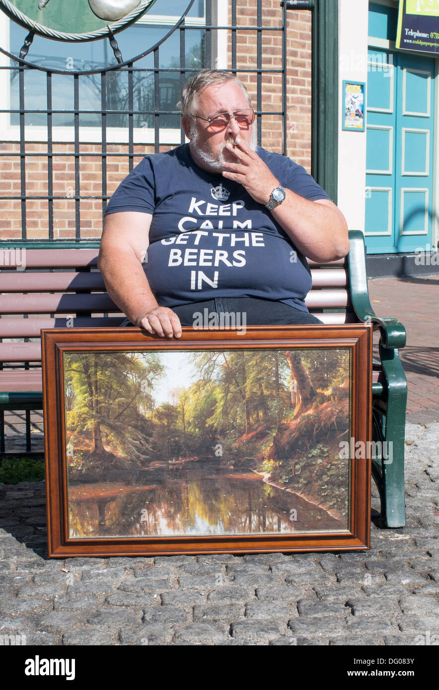 obese-man-smoking-and-holding-painting-g