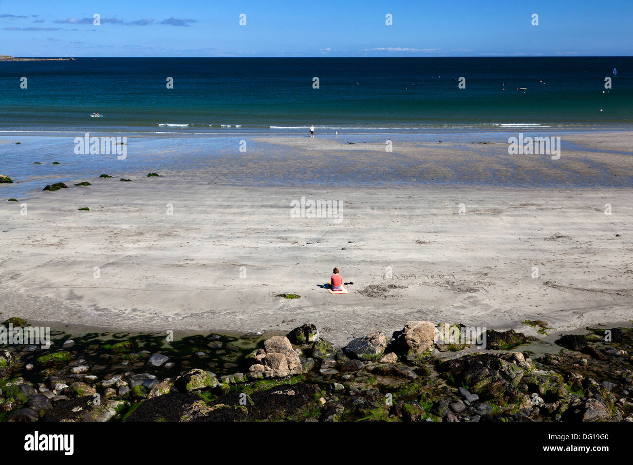 solitary-woman-sitting-on-the-beach-coverack-cornwall-DG19G0.jpg