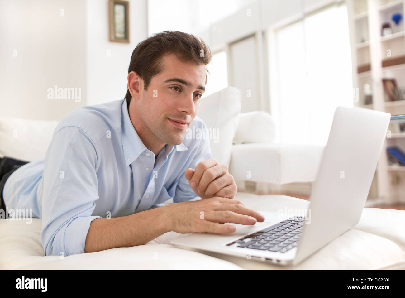Male indoor computer surf internet online mail - Stock Image