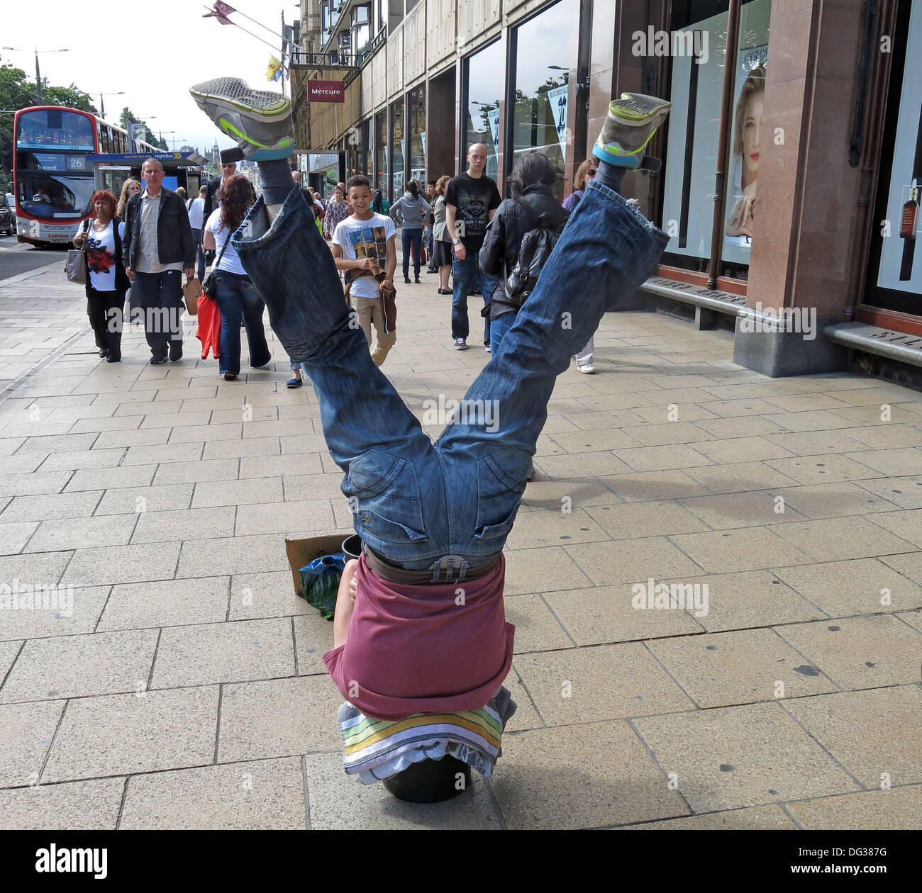 upsidedown,give,generously,street,entertainer,city,fringe,activities,weird,strange,bucket,Scotland,UK,GB,great,Britain,collecting,coins,money,cash,donations,donation,gotonysmith,Buy Pictures of,Buy Images Of