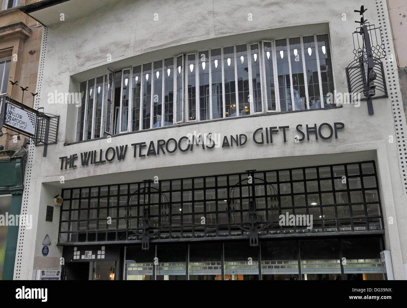 designed,by,internationally,renowned,architect,Charles,Rennie,Mackintosh,Glasgows,tearooms,cafe,Margaret,MacDonald,UK,front,exterior,smiles,better,smilesbetter,Argyle,Street,st,The,Room,Deluxe,facade,external,Scottish,tourism,tourist,destinations,independence,identity,art,style,Henderson,the,gotonysmith,Buchanan,Street,Miss,Cranston,Mackintoshs,redesigned,external,facade,was,a,carefully,considered,asymmetric,abstractly,modelled,composition,with,shallow,curves,on,some,areas,of,the,surface,and,varying,depths,of,recesses,to,windows,and,the,main,entrance.,The,composition,respected,the,urban,context,of,the,neighbouring,buildings,matching the major cornice lines and heights of adjoining buildings,whilst,still,exploring,emerging,ideas,of,Art,Nouveau,and,the,modern,movement.,The,ground,floor,entrance,door,is,placed,far,to,the,left,of,a,wide,band,of,fenestration,both of which are recessed below the first-floor level,the,location,of,the,Room,de,Luxe.,To,emphasise,the,importance,of,this,room,Mackintosh designed a full width bay window,projecting the facade outwards with a gentle curve. jewelers,Buy Pictures of,Buy Images Of