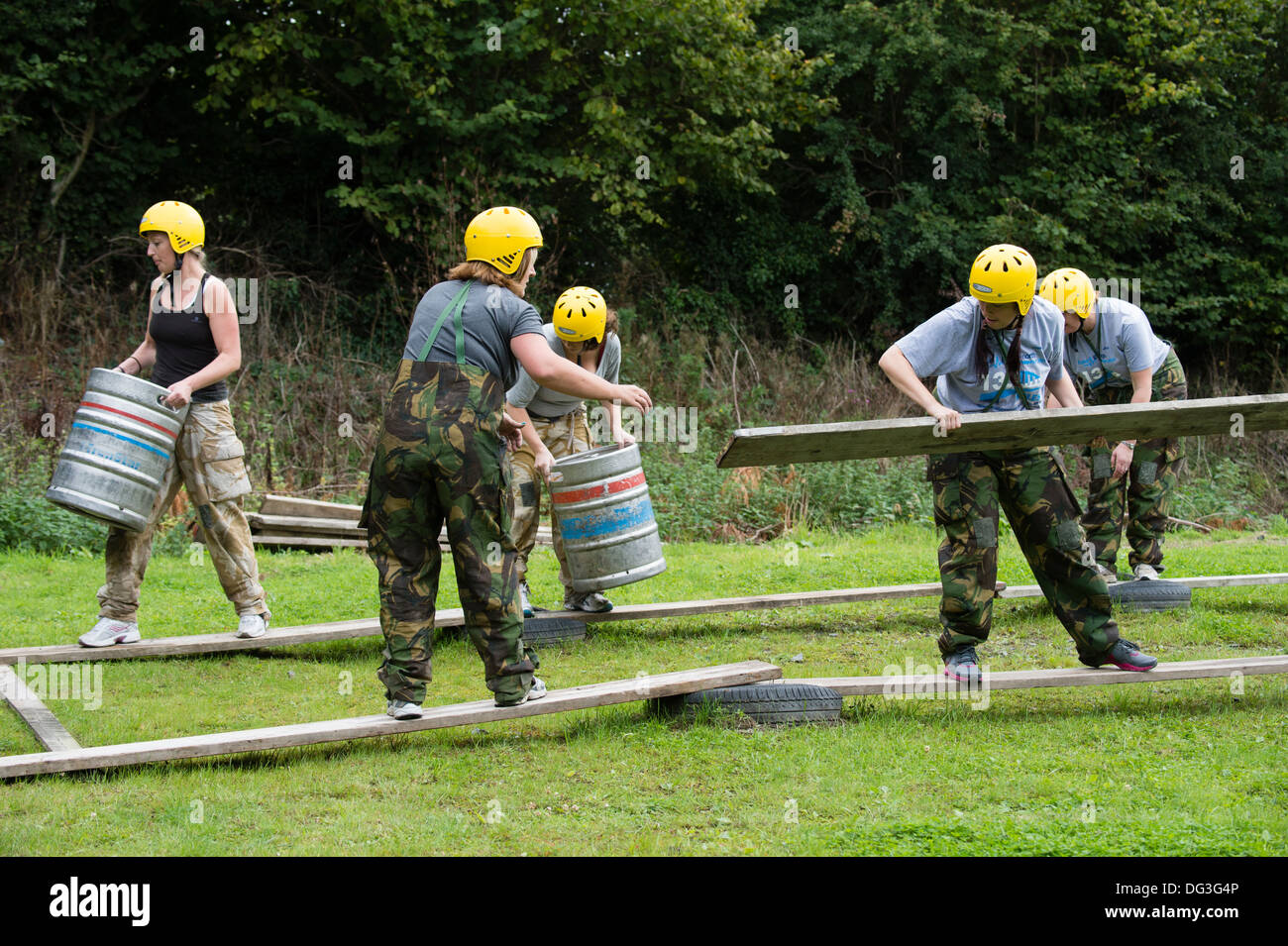 A group of adult women on a team building teambuilding exercise problem  solving outdoor pursuits workshop event UK