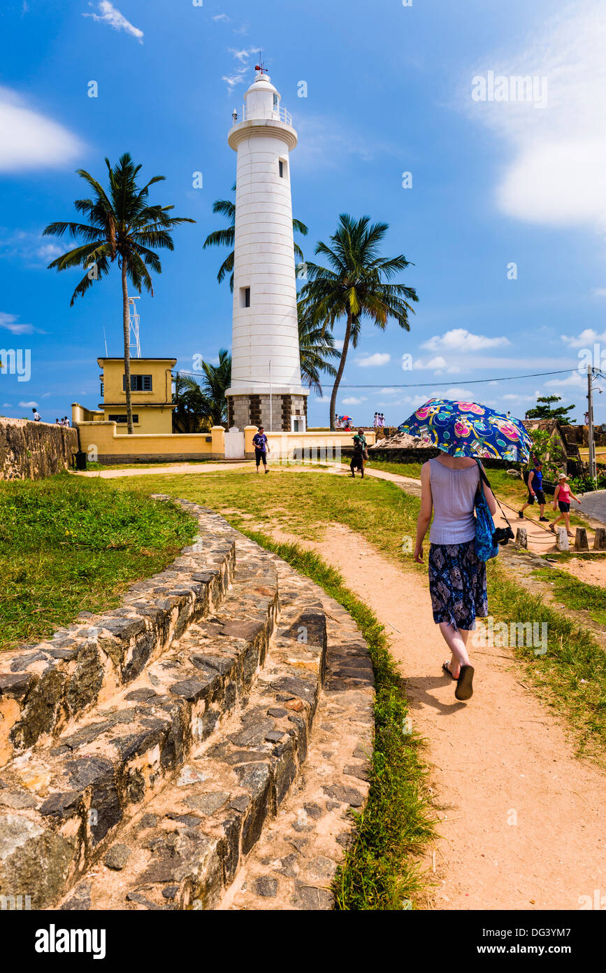Tourist visiting Galle lighthouse in the Old Town of Galle, UNESCO World Heritage Site, Sri Lanka, Asia - Stock Image