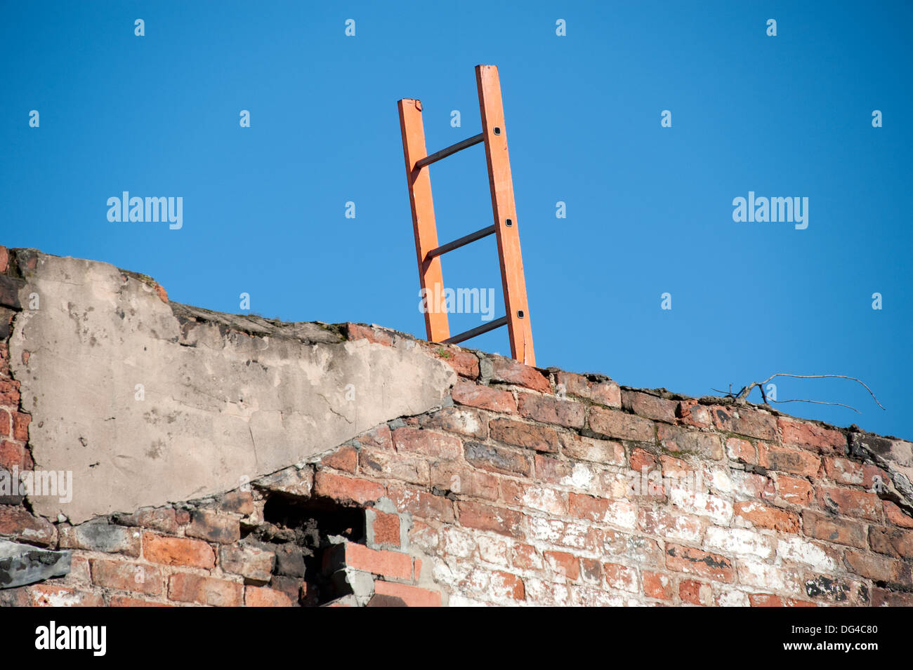 Ladder wall overcome climb over sky blue wooden - Stock Image