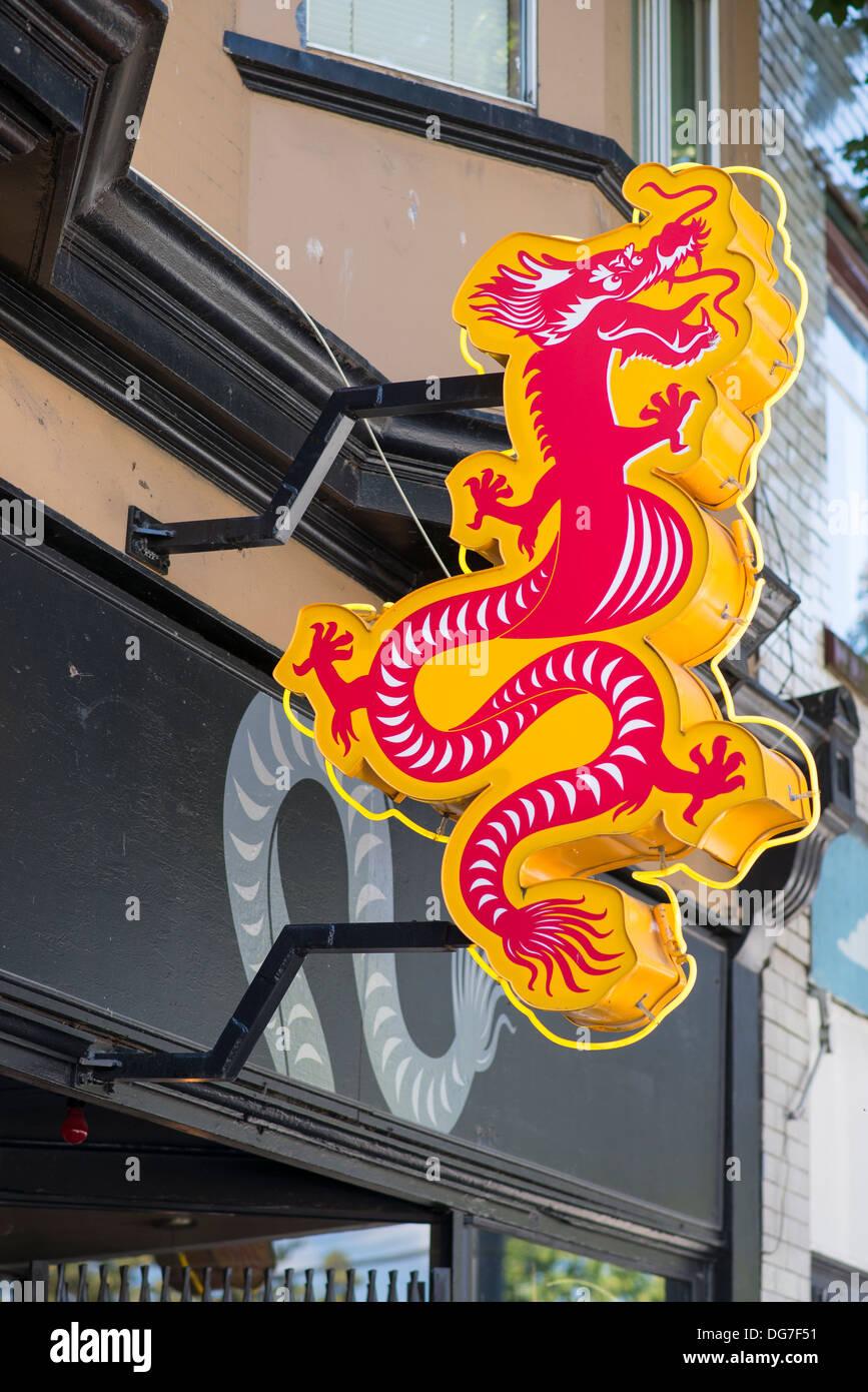 Neon dragon sign, Vancouver, British Columbia, Canada - Stock Image