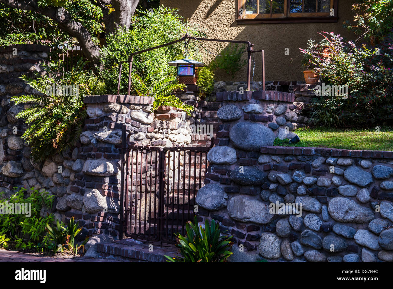 A retaining wall, gate and steps with craftsmen style lantern in Pasadena California Stock Photo
