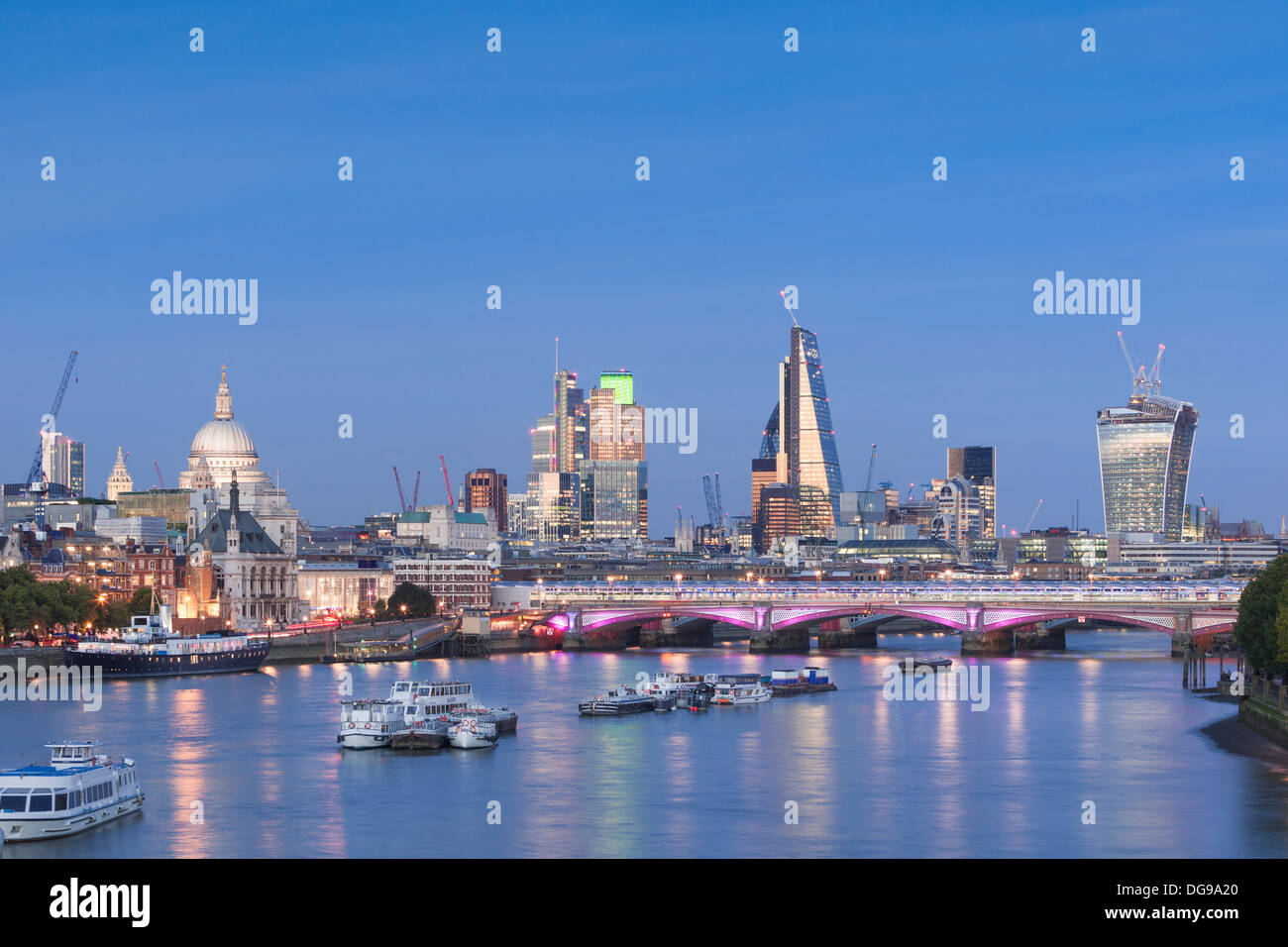 London skyline and river Thames at dusk, London, England - Stock Image