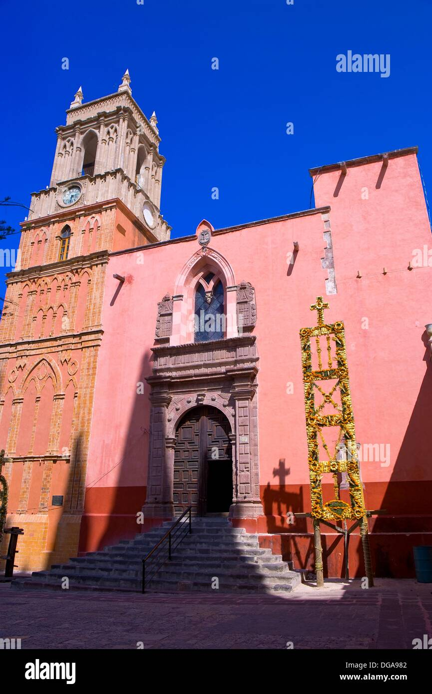 The Church of St  Michael the Archangel decorated with marigolds for La Alborada birthday of San Miguel the Archangel, - Stock Image