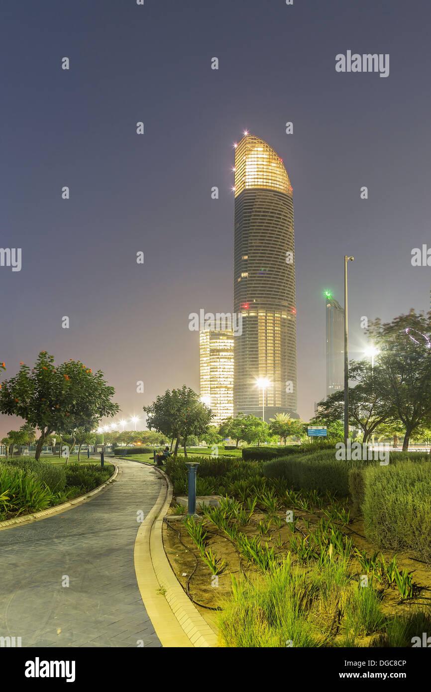 Illuminated skyscrapers at dusk, Adu Dhabi, United Arab Emirates - Stock Image