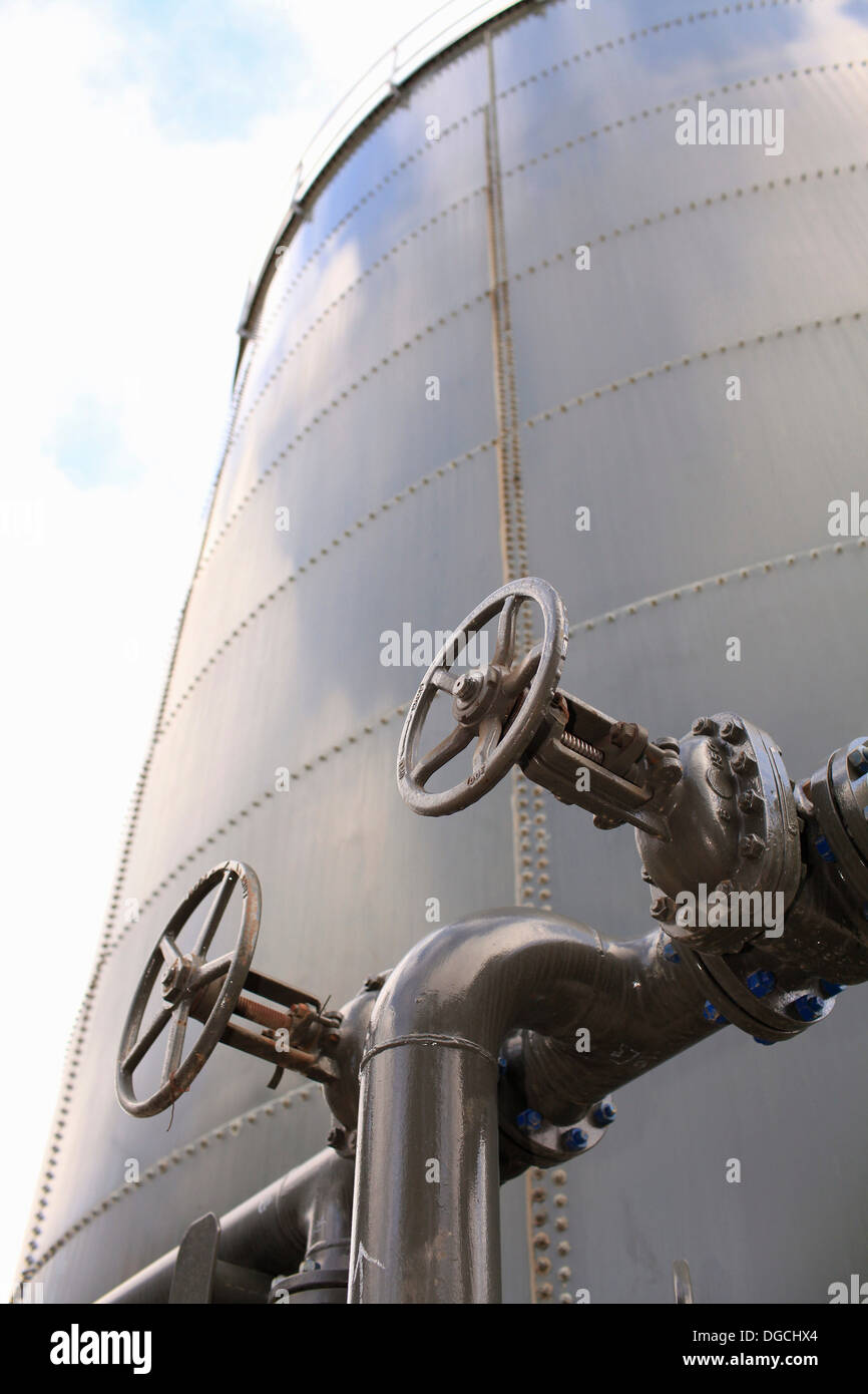 Oil storage tank, low angle view - Stock Image