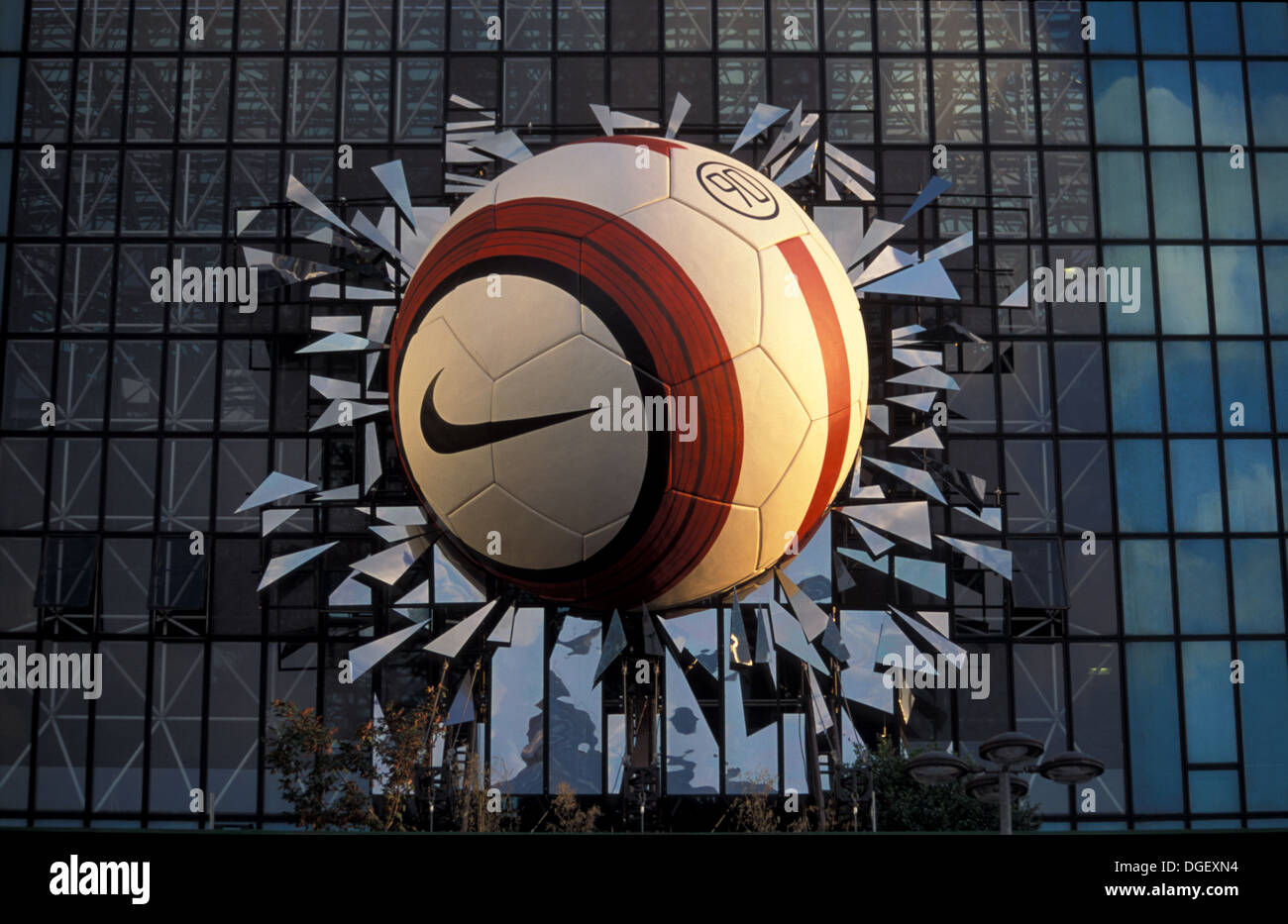 Nike Advertisement of a giant football ball simulating breaking the glasses of a building in La Defense, Paris Stock Photo