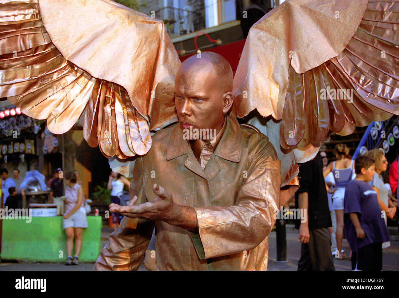 winged-street-artist-walking-in-downtown-montreal-during-the-just-DGF76Y.jpg