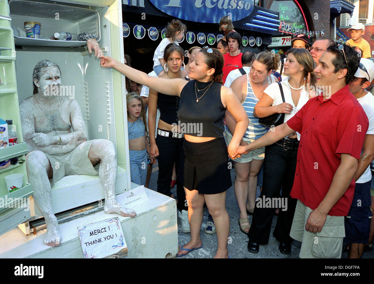 man-in-refrigerator-human-statue-performing-in-downtown-montreal-during-DGF7FA.jpg