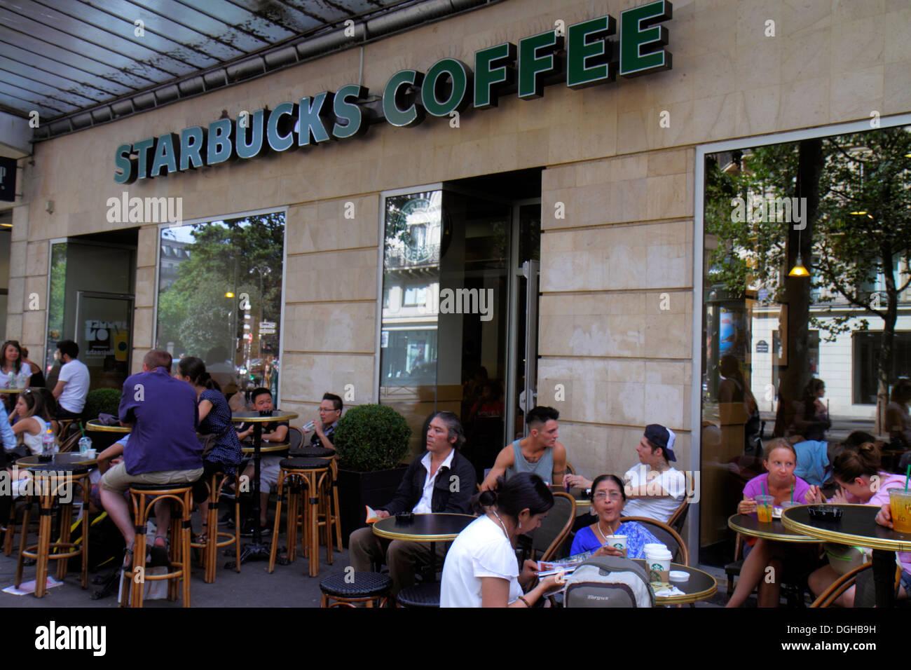 Paris France Europe French 4th Arrondissement Boulevard De Sébastopol  Starbucks Coffee Tables Chairs Customers   Stock