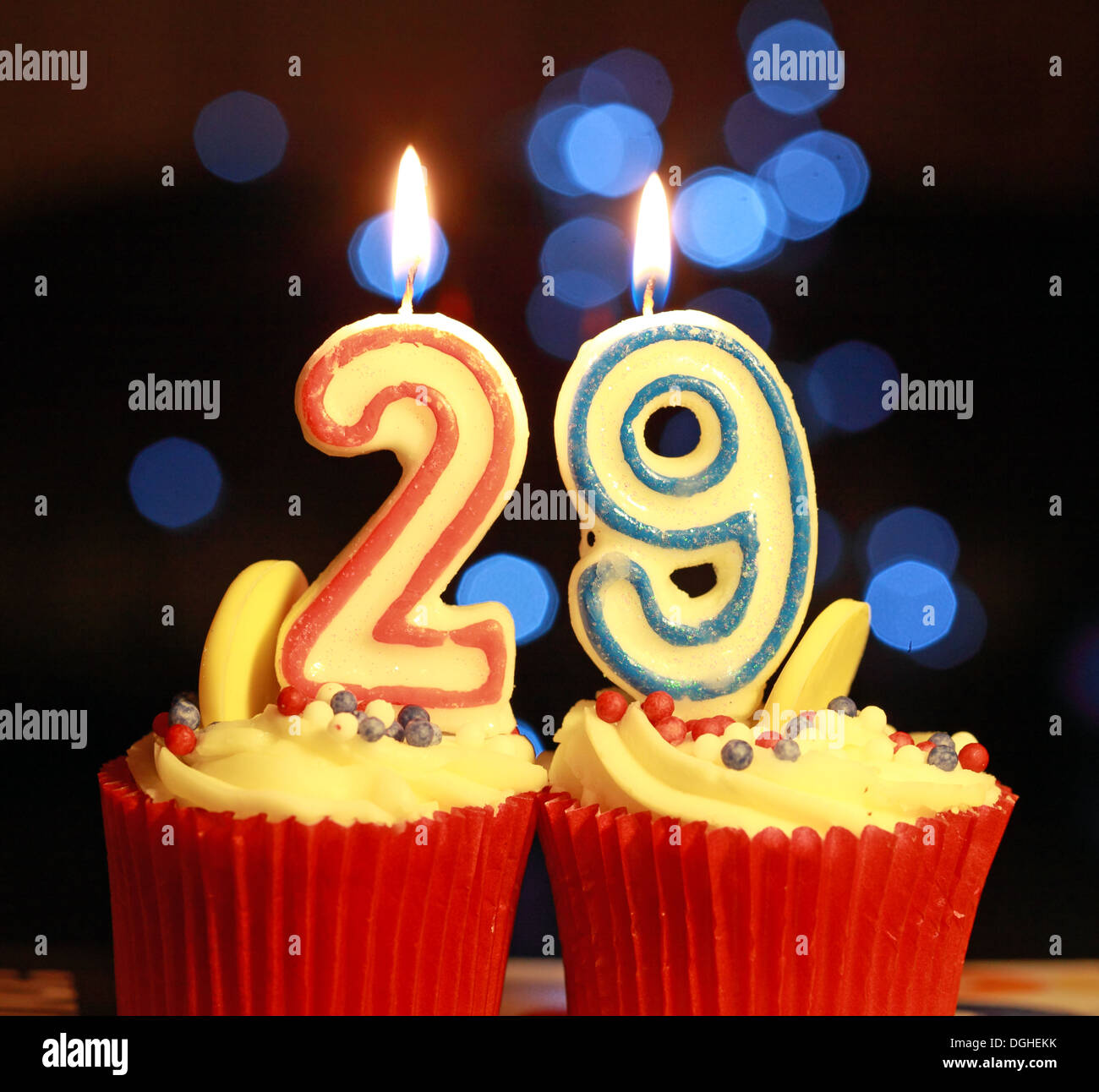 Twentynine The Number 29 As Burning Candles On Iced Muffin Stock