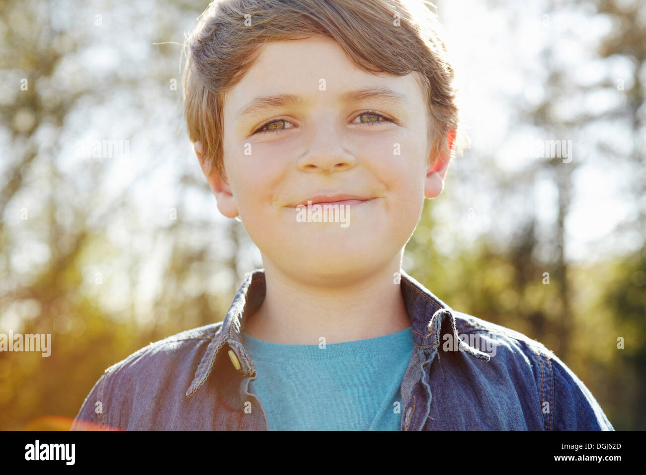 Boy with cheeky grin - Stock Image