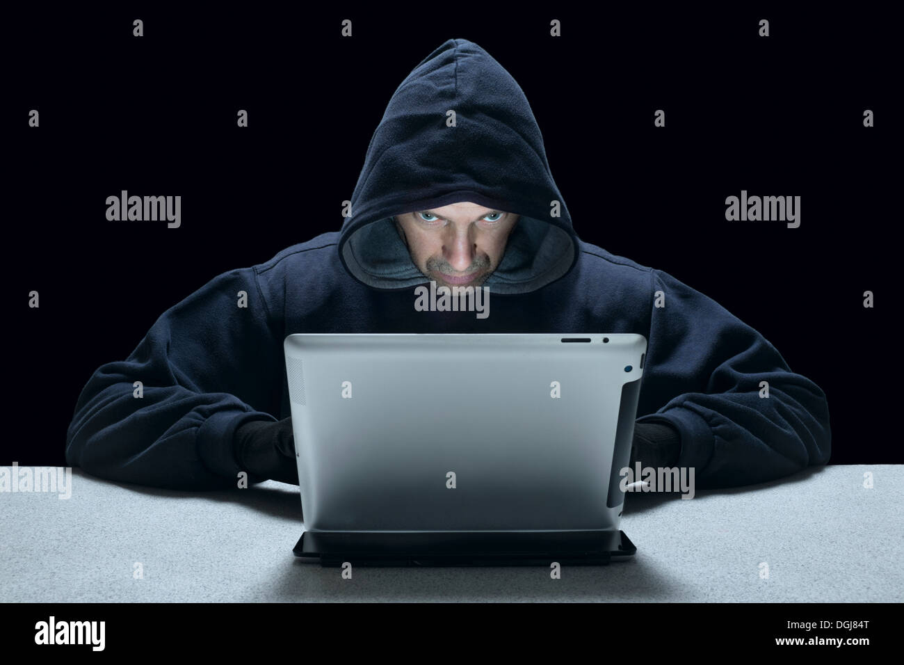 a hooded man representing a cyber criminal stock photo 61867144 alamy