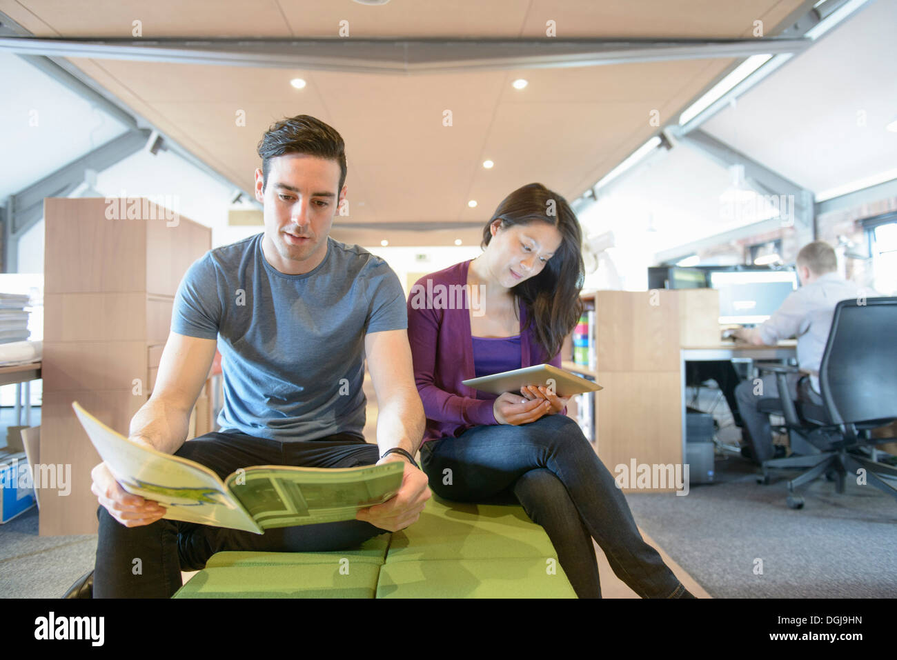 Business colleagues taking a break in modern office - Stock Image