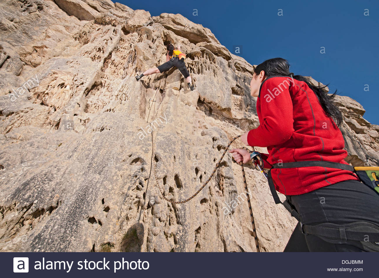 Two female rock climbers on cliff - Stock Image