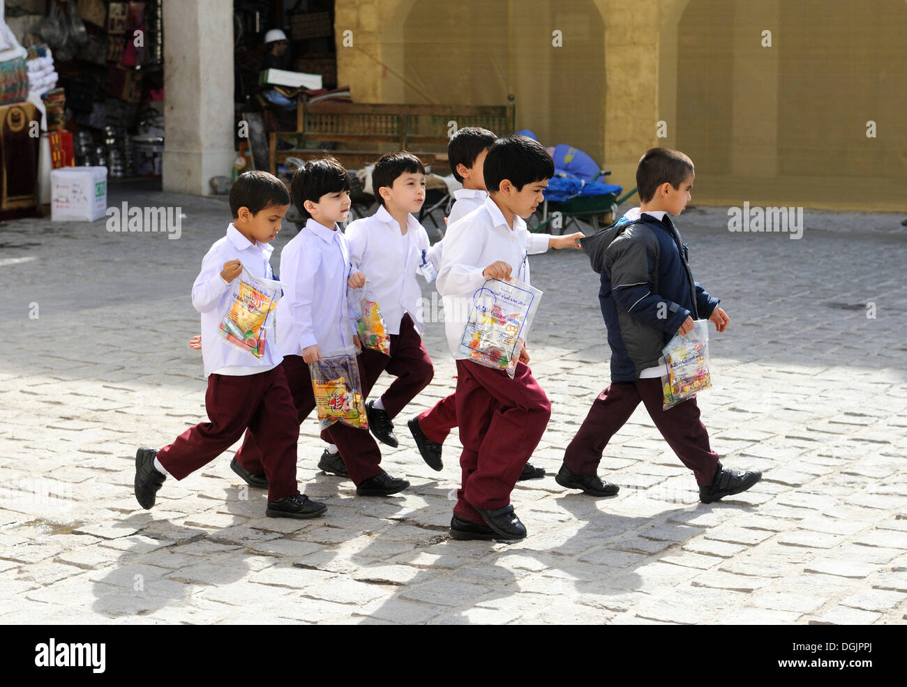 School children wearing school uniforms, Doha, Qatar, Arabian Peninsula, Persian Gulf, Middle East, Asia - Stock Image