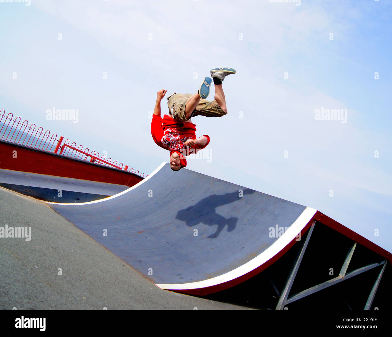 A parkour athlete performing a somersault. - Stock Image