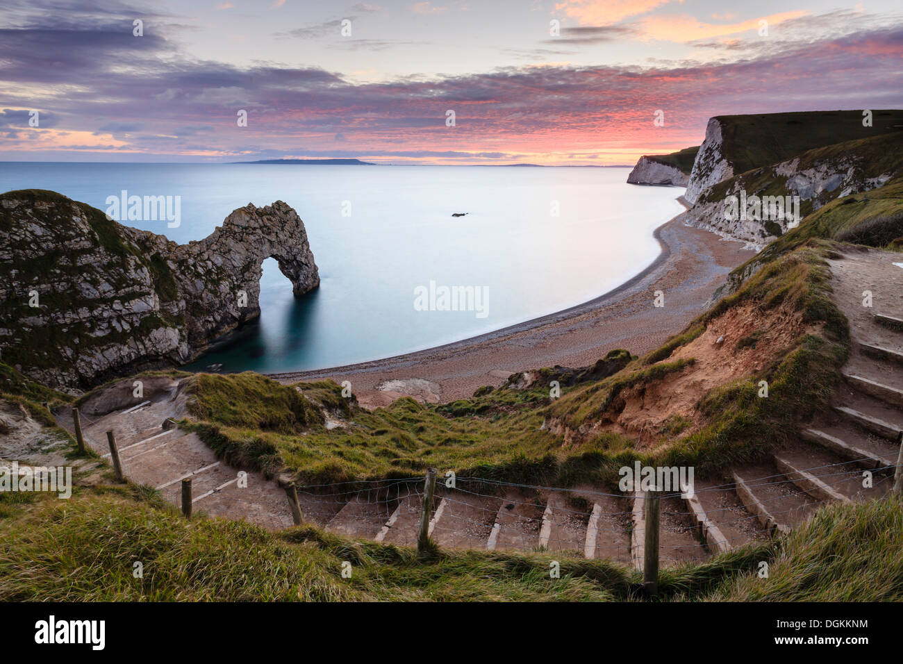 A view of Durdle Door from the cliff top path. - Stock Image