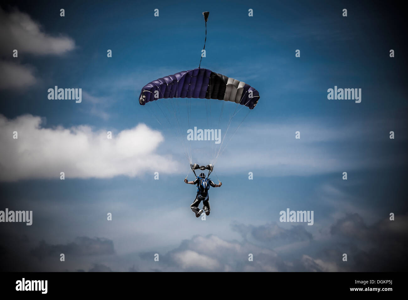 skydiver-landing-with-parachute-open-and