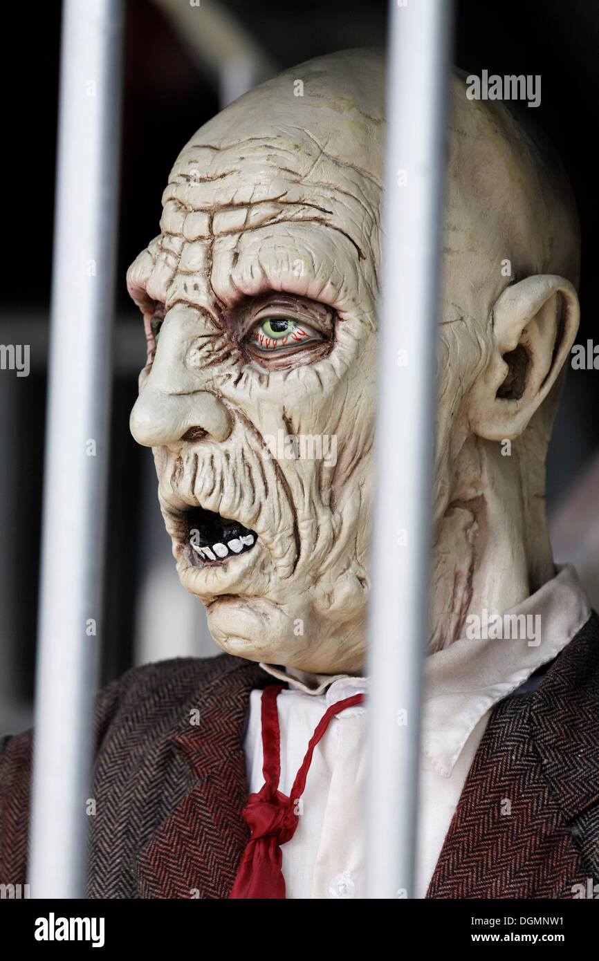 Man behind bars, desperate face, haunted house figure - Stock Image