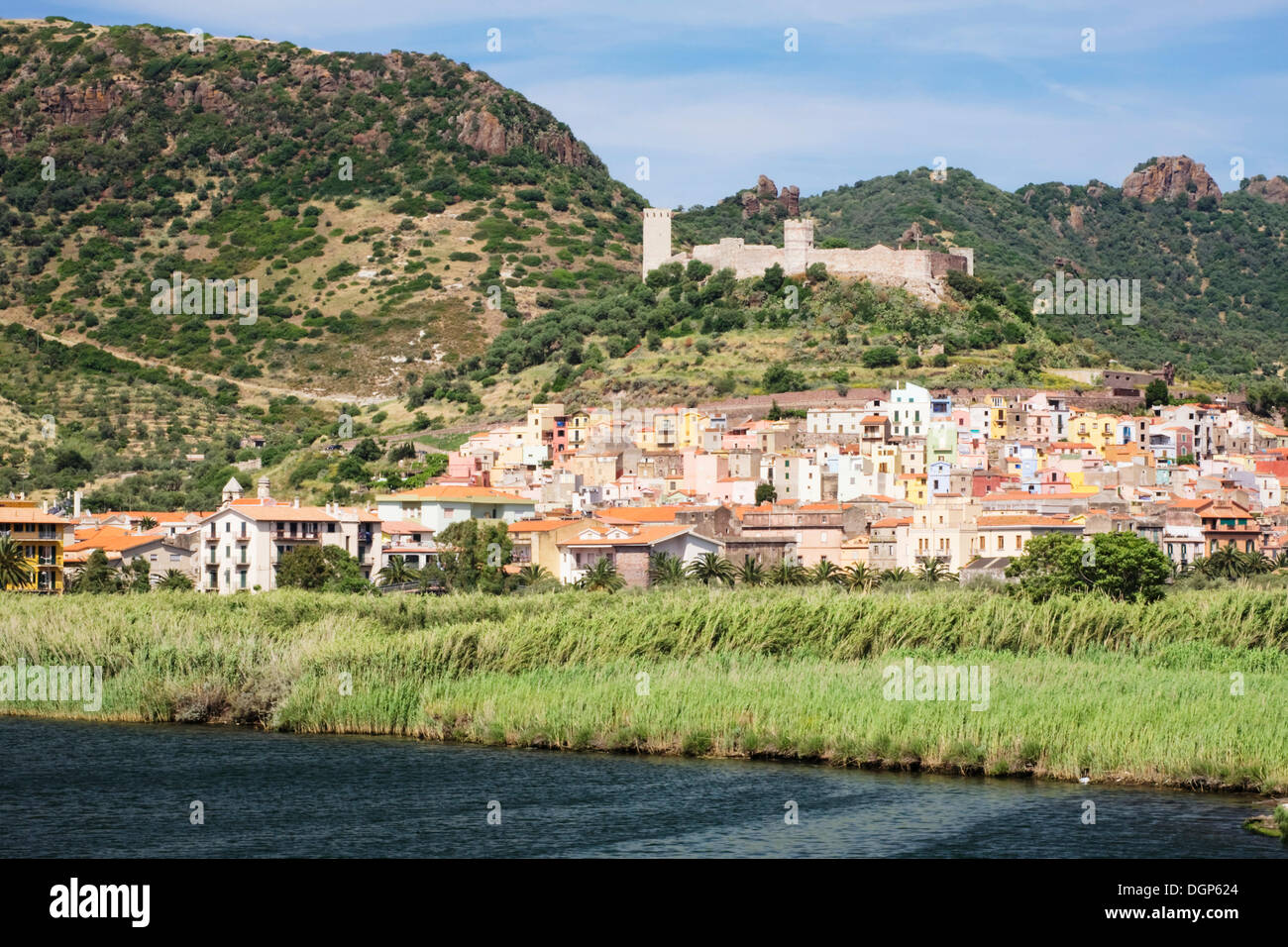 Bosa amid fertile fields in front of a Genoese fort, Oristano, Sardinia, Italy, Europe - Stock Image