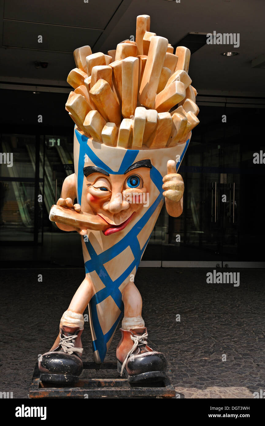 Bag of french fries, an advertising figure in front of a store in Stralsund, Mecklenburg-Western Pomerania - Stock Image