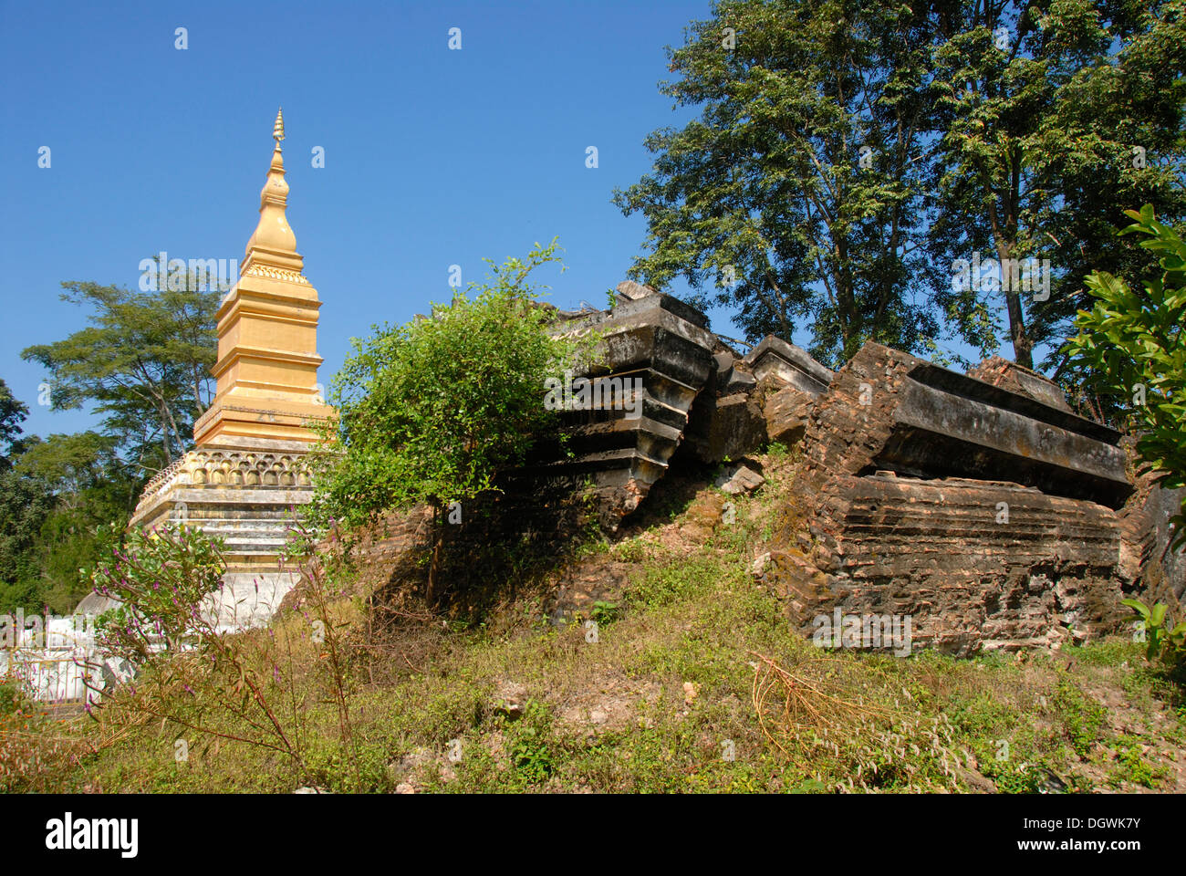 Theravada Buddhism, destruction, new stupa and old stupa destroyed in a bomb attack in the Vietnam War - Stock Image