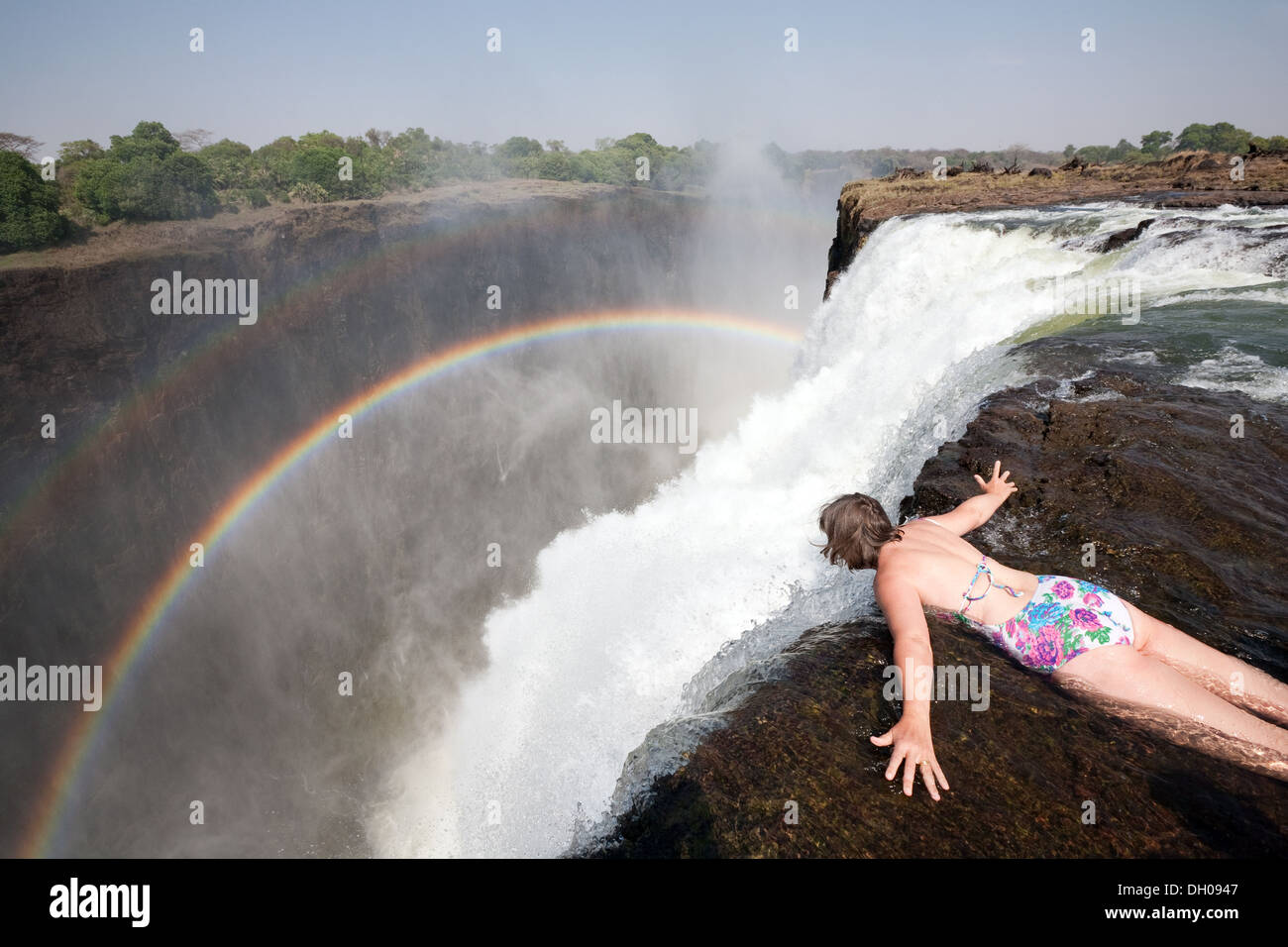 middle-aged-caucasian-woman-looking-over-the-edge-of-victoria-falls-DH0947.jpg