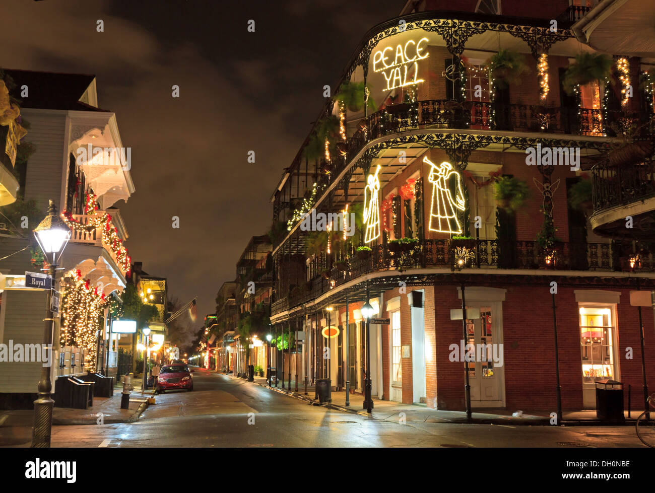 Christmas Lights on the corner of Royal and Dumaine Streets spell out 'Peace Y'All' in the French Quarter of New Stock Photo