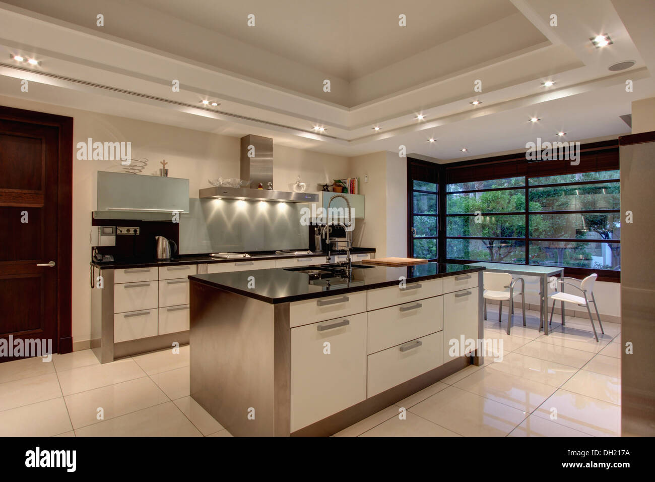 Down lighting on false ceiling in modern Spanish kitchen with Stock ...
