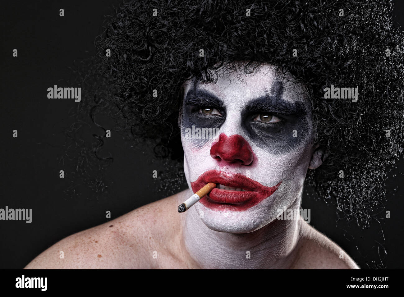Evil Spooky Clown Portrait on Black Background - Stock Image