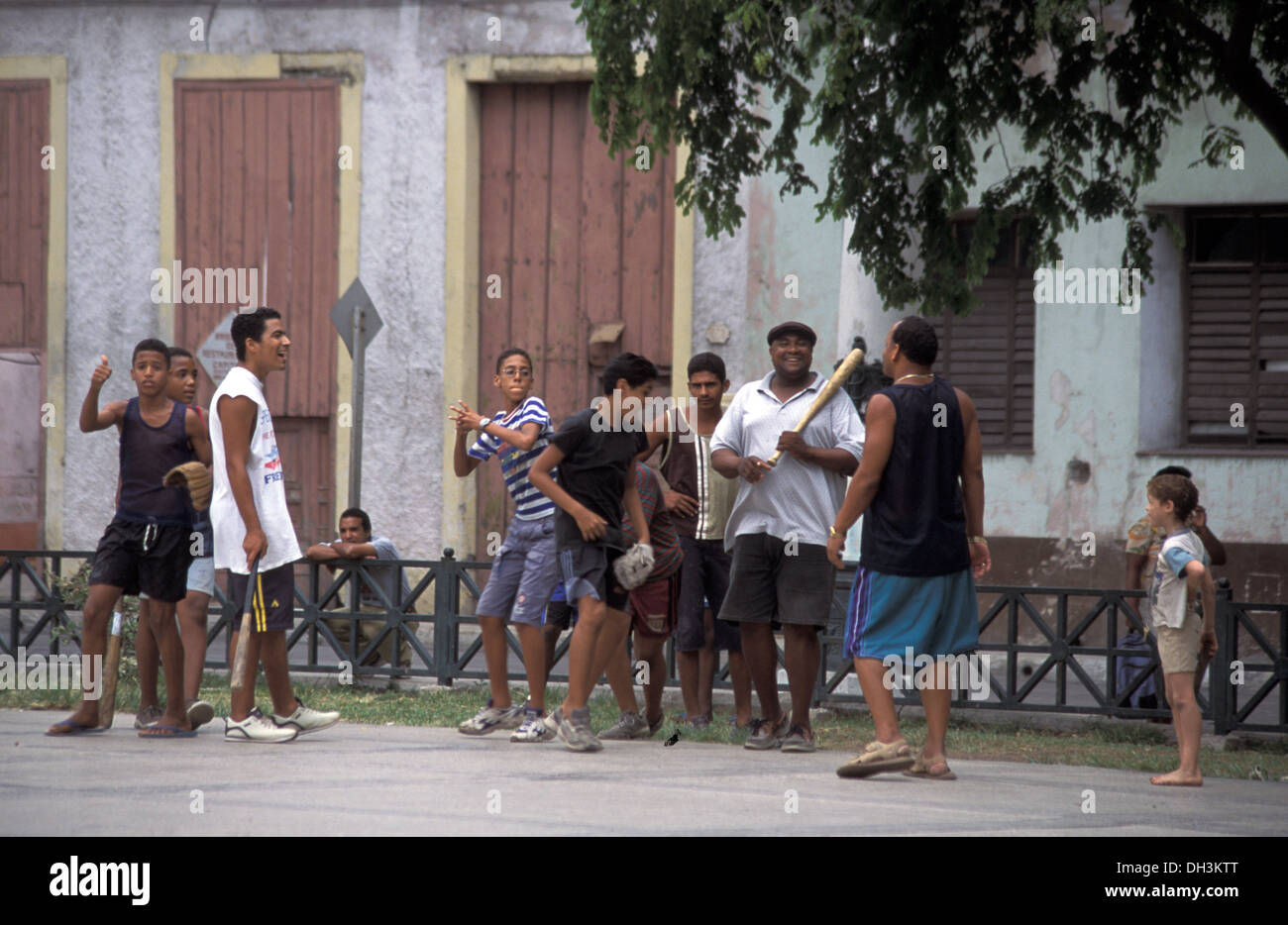 Cuban boys playing baseball in a Havana street, Cuba Stock Photo