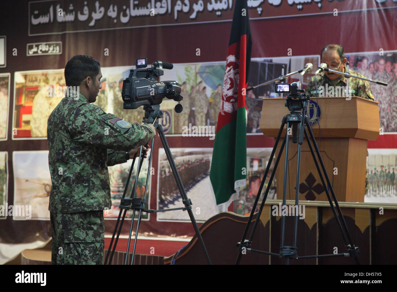 Afghan National Army public affairs soldier prepares his camera to record the ANA 203rd Corp's Quarterly Training - Stock Image