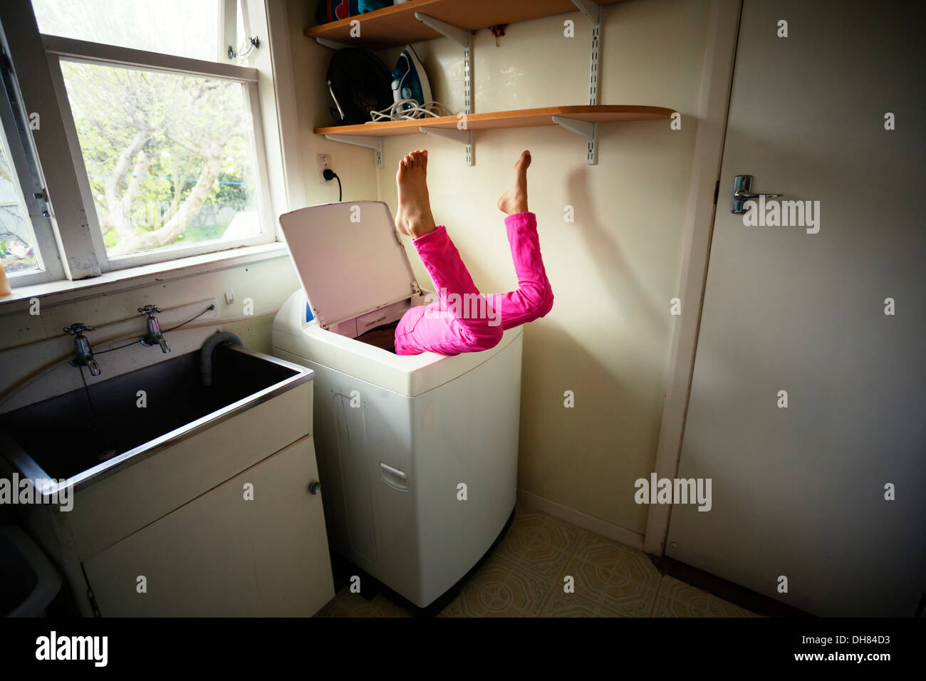Laundry room accident - Stock Image