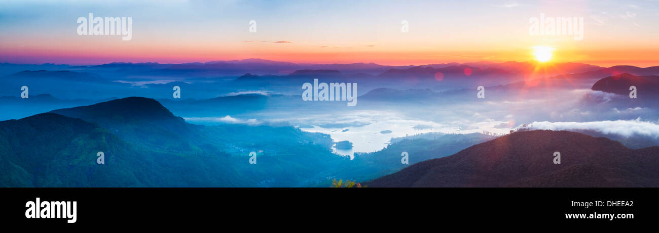 Adams Peak (Sri Pada) view at sunrise, mountains and the Maussakele Reservoir, Central Highlands, Sri Lanka, Asia - Stock Image