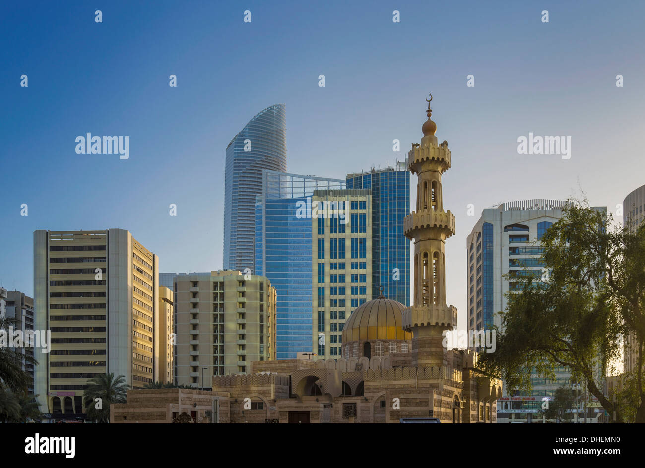 Mosque and modern buildings downtown Abu Dhabi, United Arab Emirates, Middle East - Stock Image