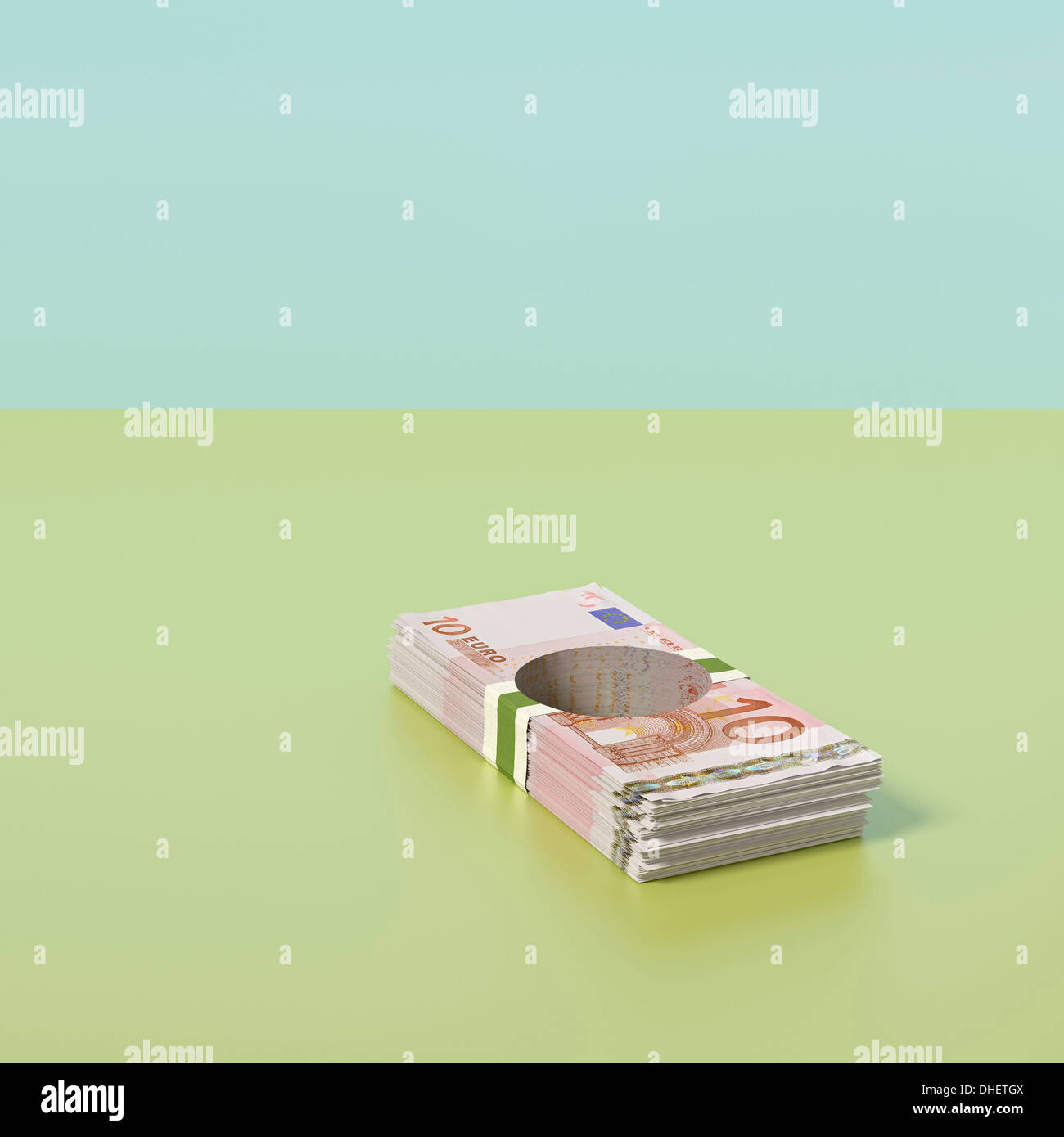 Pile of Euro notes with hole through the middle - Stock Image