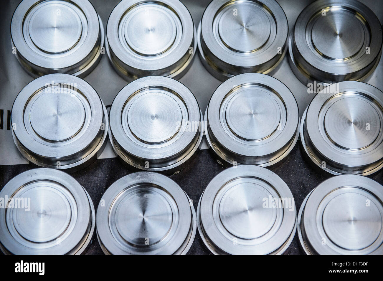 Stacks of raw and unworked steel discs in factory, overhead view - Stock Image