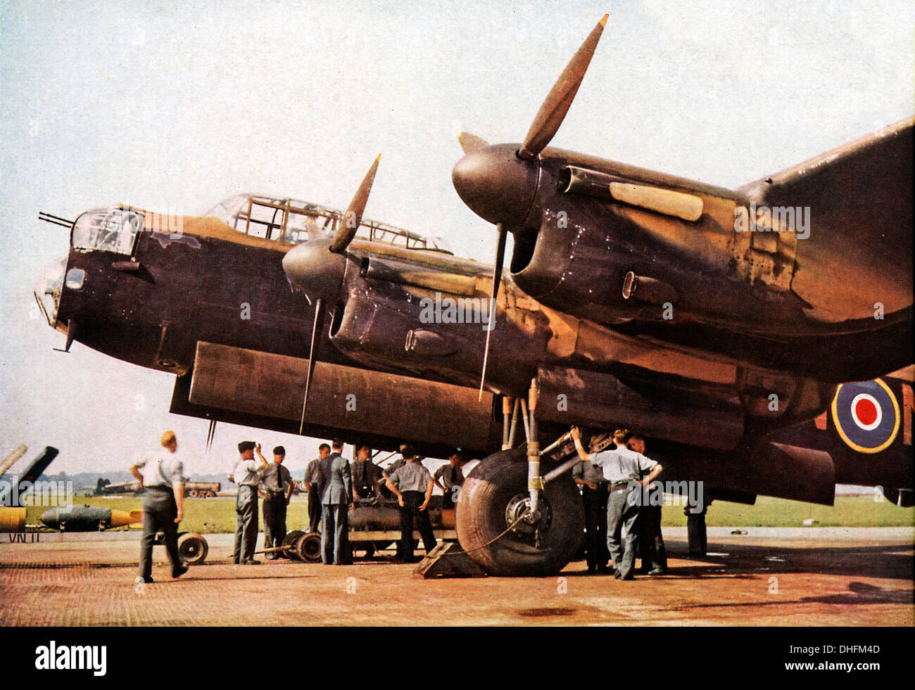 Loading a Lancaster Bomber, 1942 colour photo of the iconic RAF heavy bomber bombing up before a raid on Germany Stock Photo