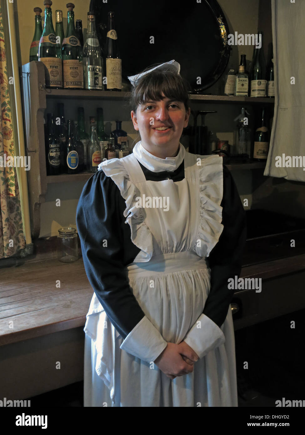 National,Trust,GB,Great,Britain,British,English,NT,Cheshire,England,UK,hat,smock,uniform,woman,lady,girl,female,a,bottles,bottle,pantry,down,stairs,downstairs,Gotonysmith