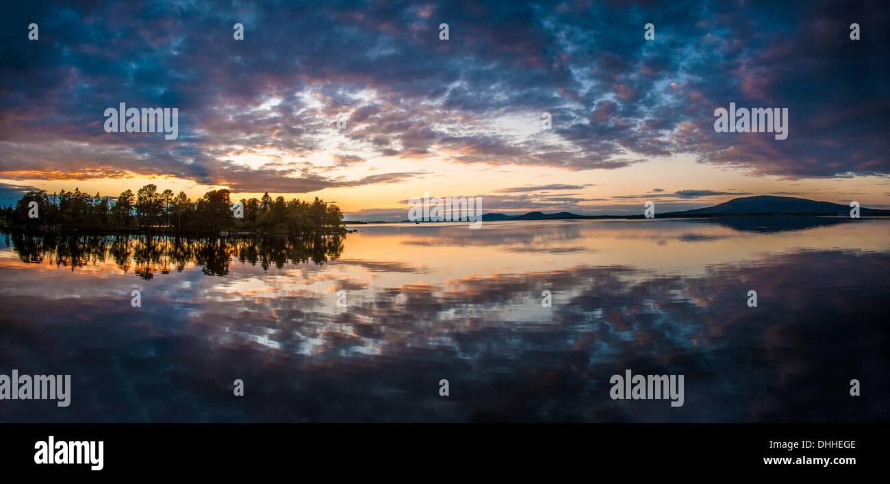 Reflection on lake at dawn, Arjeplog, Lapland, Sweden - Stock Image