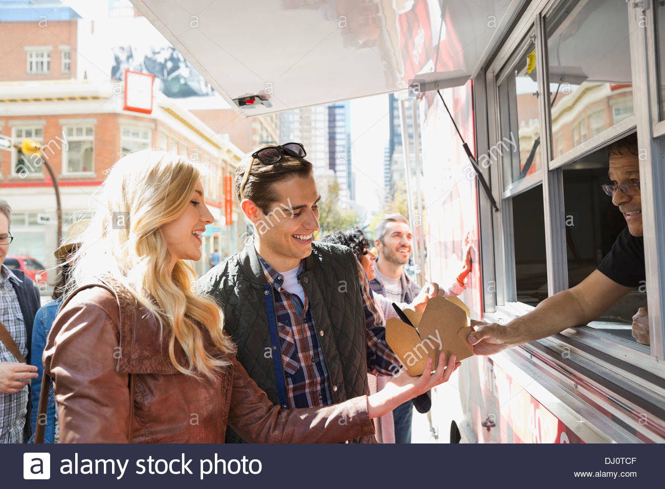 Couple ordering from a food truck - Stock Image