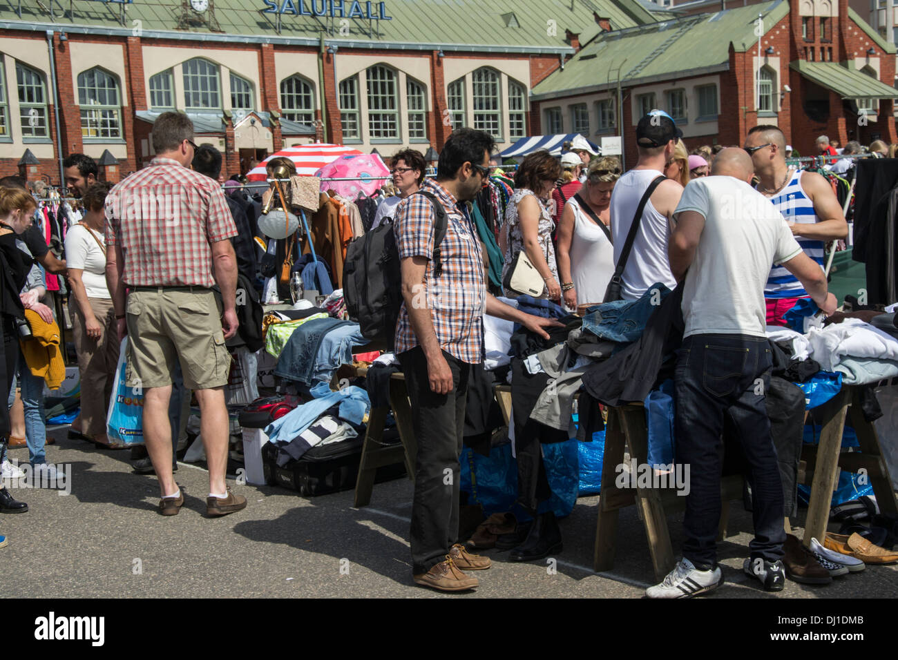 Used clothes for sale at Hietalahti Market place in Helsinki Finland Stock Photo