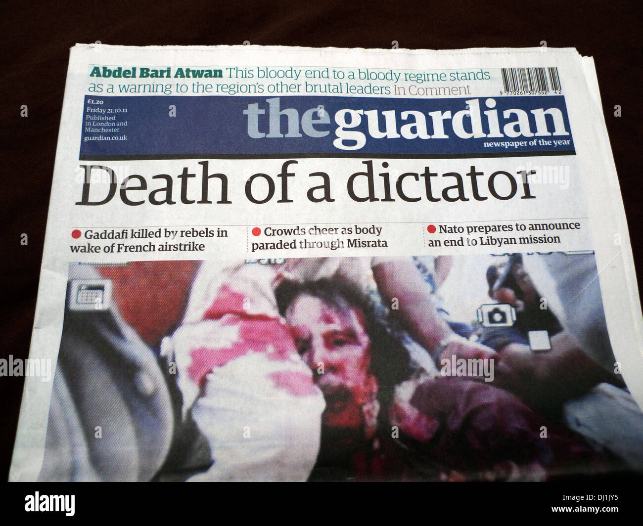 """""""Death of a dictator"""" front page cover of the Guardian newspaper reports death of Gaddafi London 21 October 2011 Stock Photo"""
