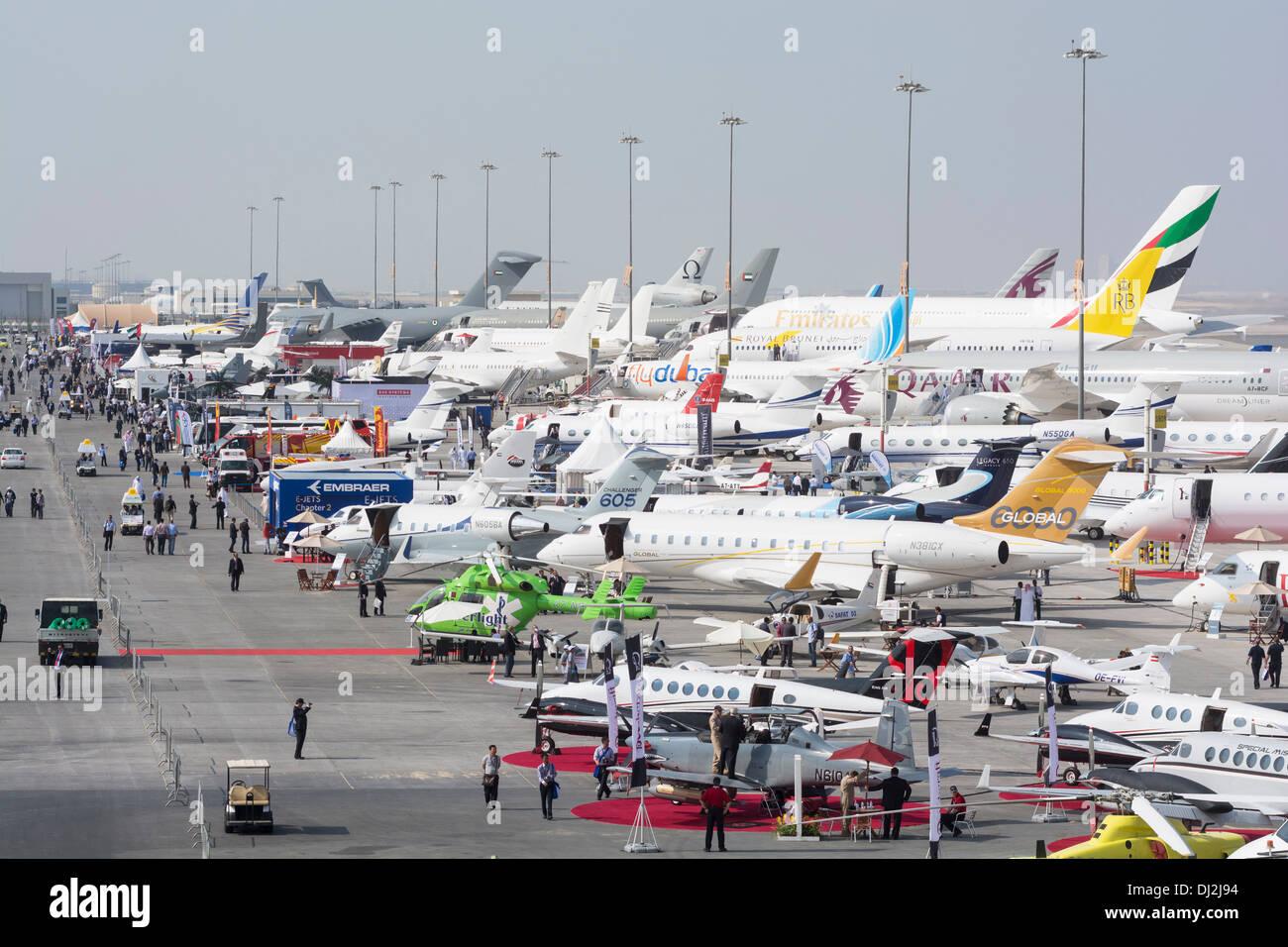 Many aircraft on apron at Al Maktoum International airport during Dubai Airshow 2013 in United Arab Emirates - Stock Image
